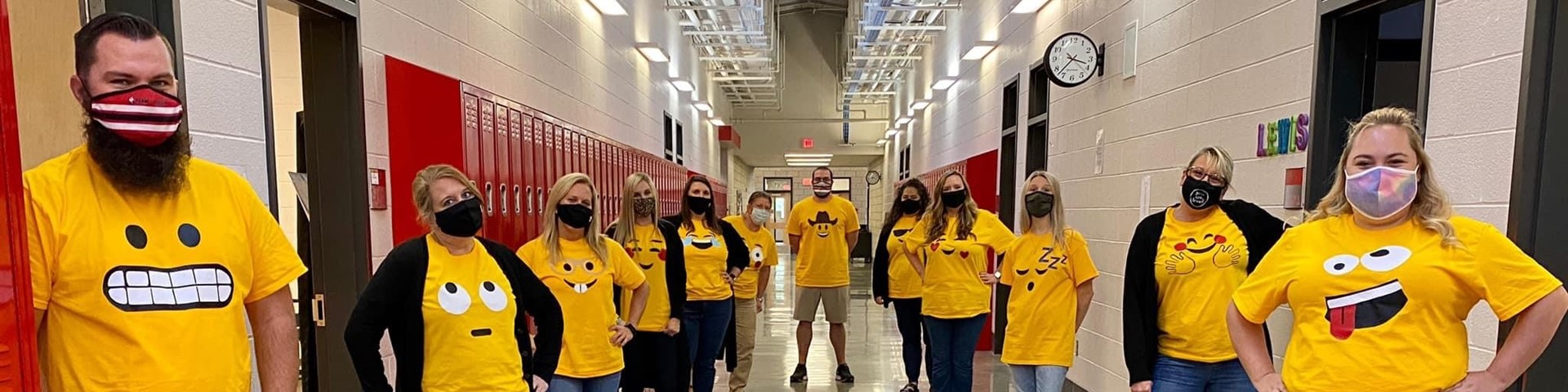 Middle School Teachers Wearing Their Emoji Shirts