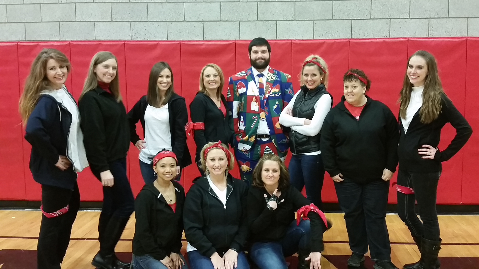 Mrs.Brake, Mrs.Dotson, Mrs.Young, Mrs.Ward, Mr.Thompson, Mrs.Conley, Mrs.Jervis, Mrs.Pridemore, Mrs.Grant, Mrs.Stephens, and Mrs.Sparks posing together in the gym.